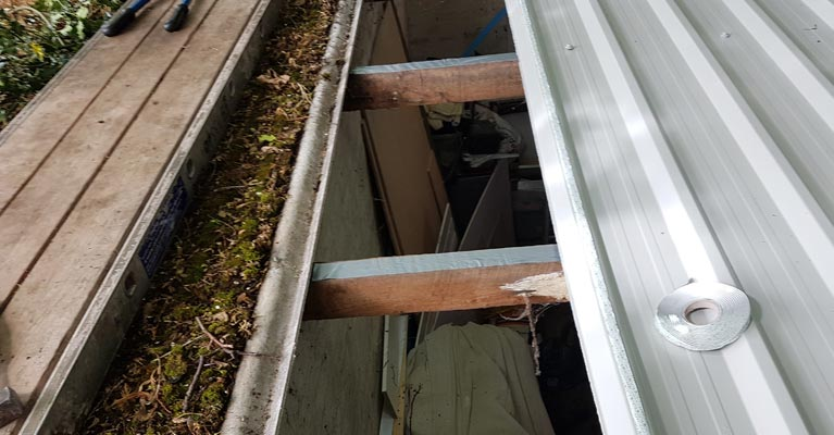 New plastisol coated steel profiled sheeting replacing low risk asbestos cement panels.