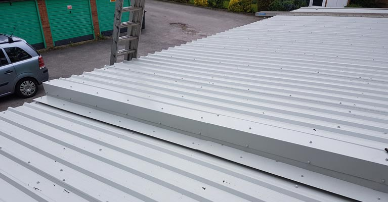 Step-up flashing joint installed to join two roof levels.