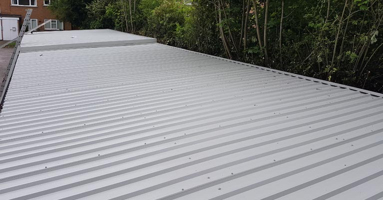 Completed 35 metre long and 6 metre wide metal cladding roofing in Sutton Coldfield.