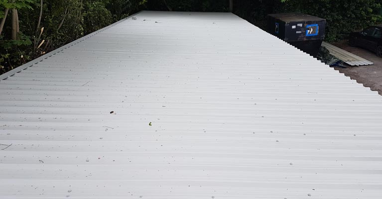 Plastisol coated steel profiled sheeting fitted by IRM Roofing.