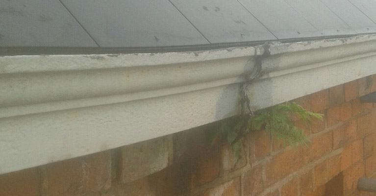 The church roof gutter joint was leaking causing moss to grow