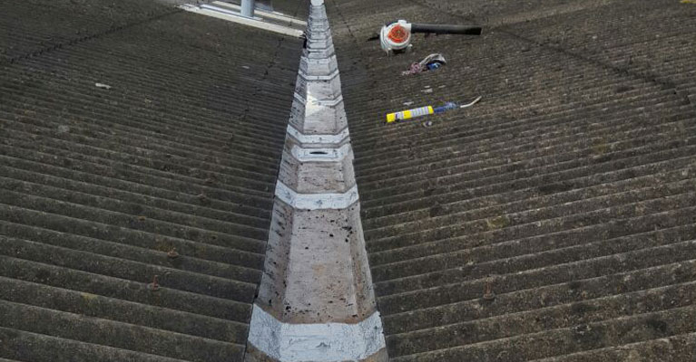 Walsall industrial valley gutter cleaning at completion, with Flexacryl applied.