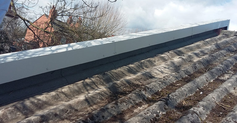 Back edge view of the fitted and completed plastisol coated steel cap flashings.