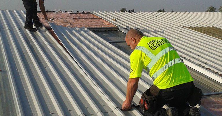 Our Banbury industrial roofing experts fitting the metal panels.