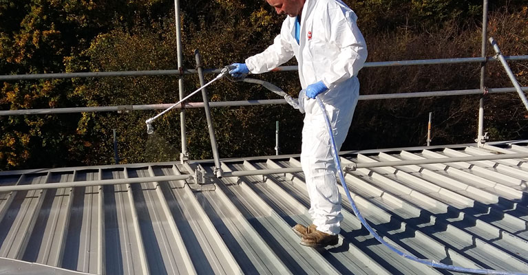 Acrypol Metalkote roof coating being applied to industrial roof in Swindon.
