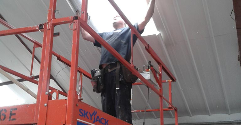 Installing internal rooflights during the internal roof repairs in Walsall