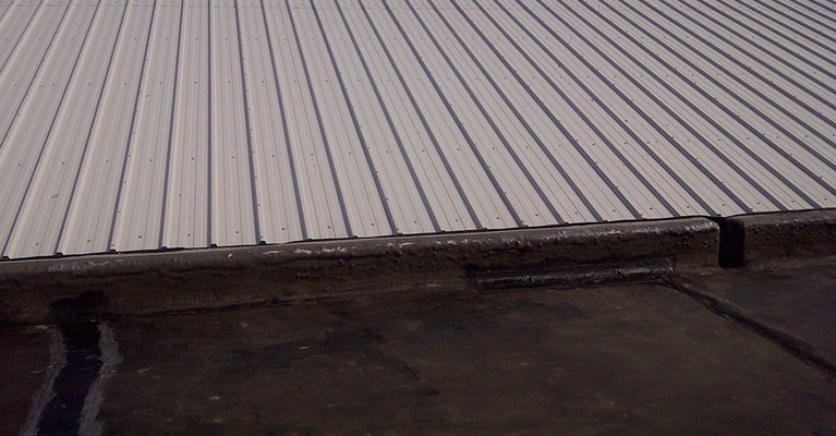 Asbestos roofing replaced with insulated composite panels