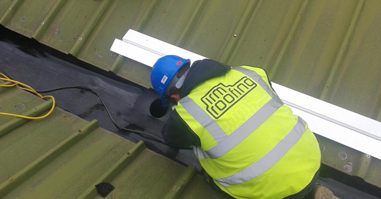 One of our Plygene installers in Stafford welding a gutter outlet in position