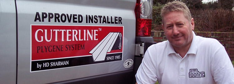 IRM Roofing founder Andy Smith alongside the Plygene logo on one of our Industrial Roofing vans