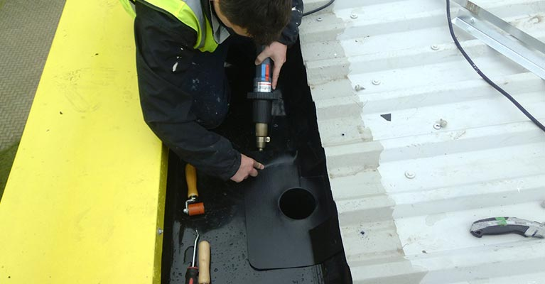 Using a heat gun to weld a Plygene outlet into position