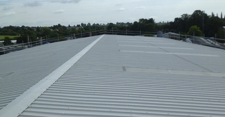 Industrial roof re-painting in Rugby