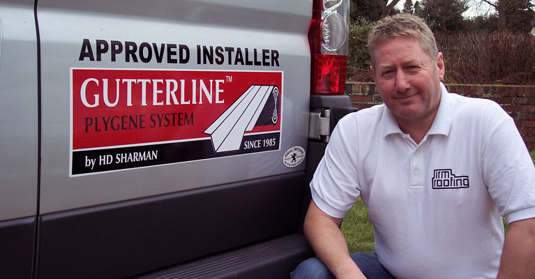 Our founder Andy Smith alongside Plygene logo on one of our Industrial Roofing vans