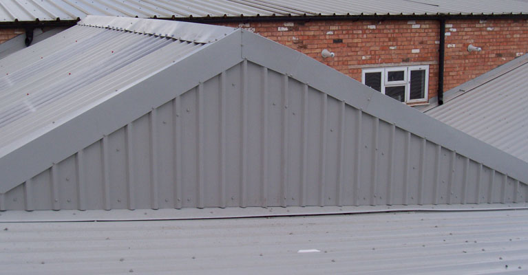 Over clad roof with metal profile sheeting